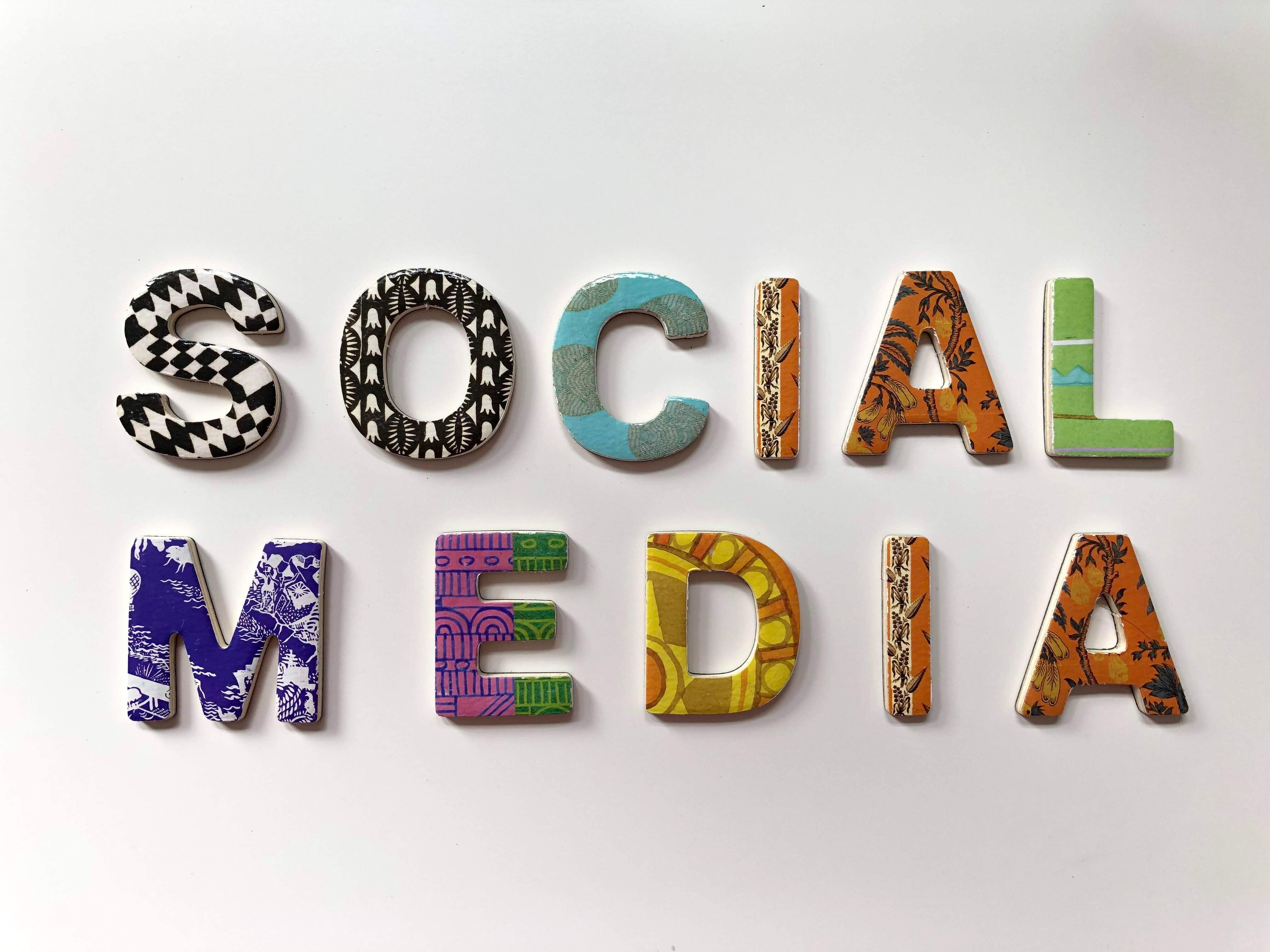 social media written on white wall in colourful letters