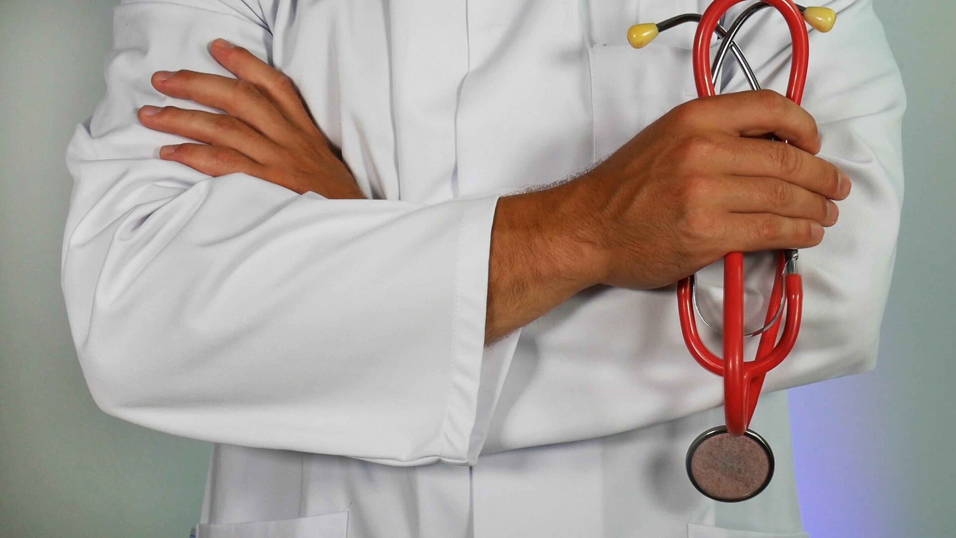 person in white doctors gown with stethoscope